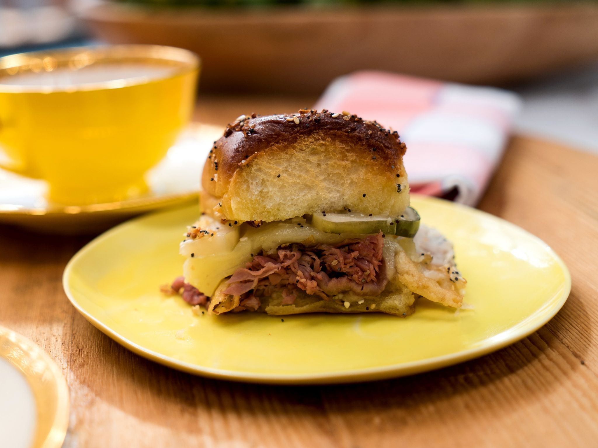 "baked roast beef and provolone ""tea"" sliders on everything buns"