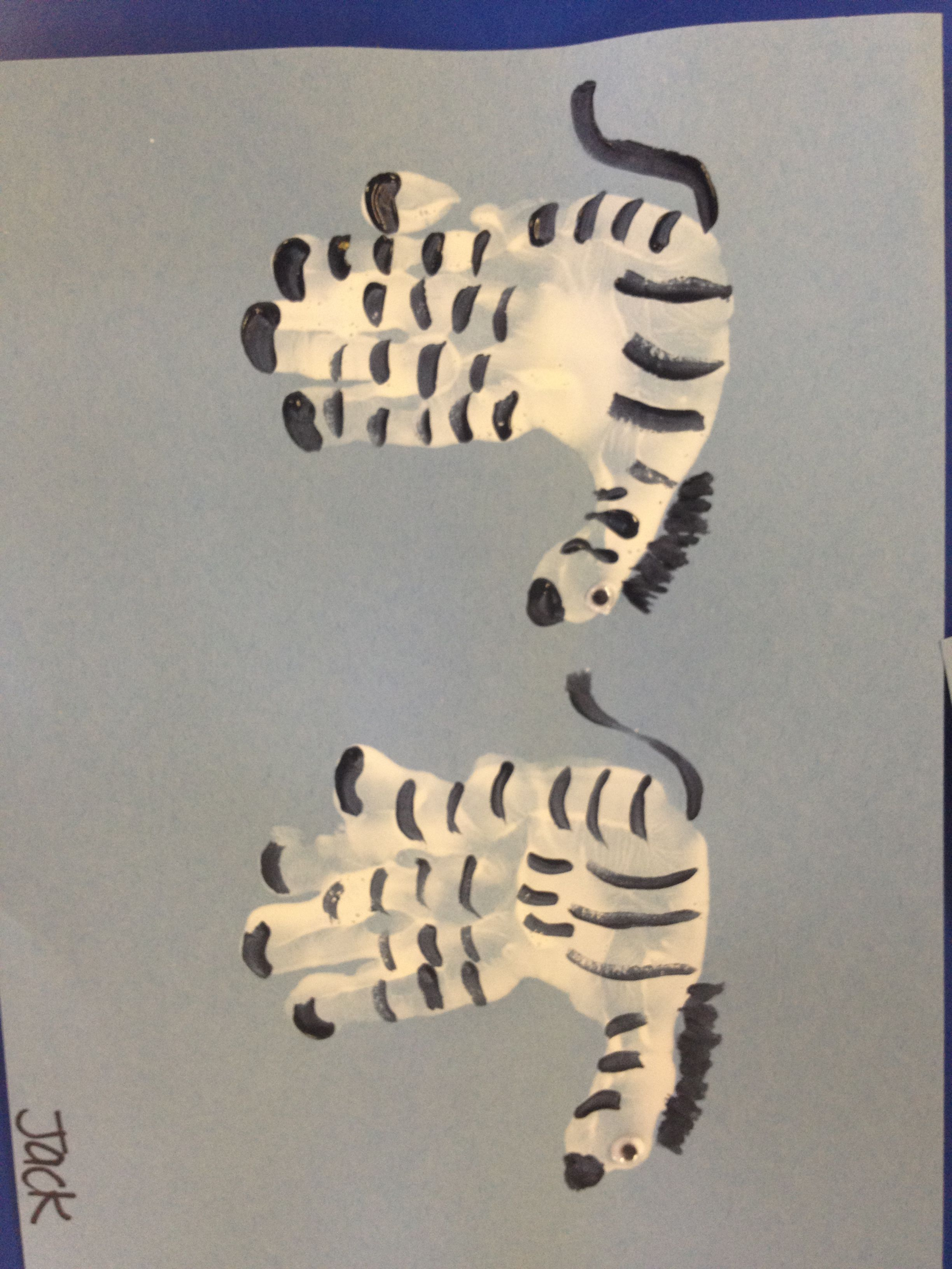 Zebra hand print pinterest zebra craft hand print for Hand and feet painting ideas
