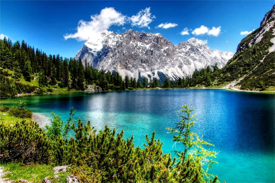 Germany S Lake Eibsee Beauty In Bavaria Curly Hair Airfare In 2020 Germany Travel Destinations Day Trips Zugspitze