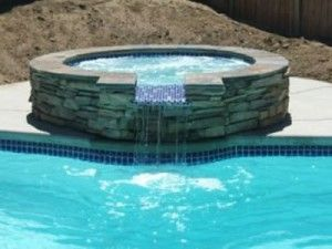 Spill Over Spa Great Idea For An In Ground Pool Pool Swimming Pool Construction Fiberglass Swimming Pools