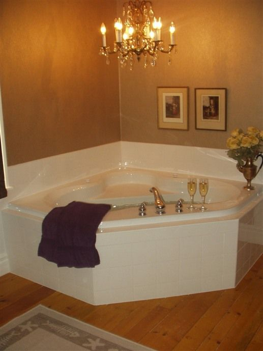 bathtub with chandelier at surfside inn - queensland, nova scotia