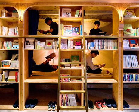 Guests enjoy reading books in their beds at book and bed for Book hotels