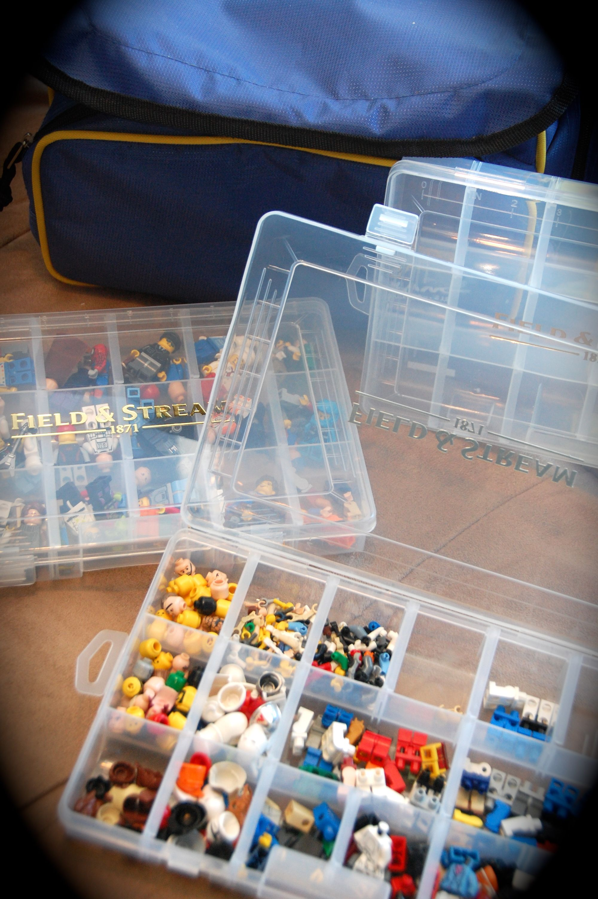 """Lego Storage: My boys have 1000s of Legos. We have lots of ways to store them...but I found this to be a great idea for the """"organized"""" boy! A soft tackle box that has the snap cases inside. Also a great way to travel with Legos as well :)"""