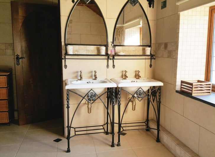 Black Iron Bathroom Console Sinks And Oval Wrought Mirror