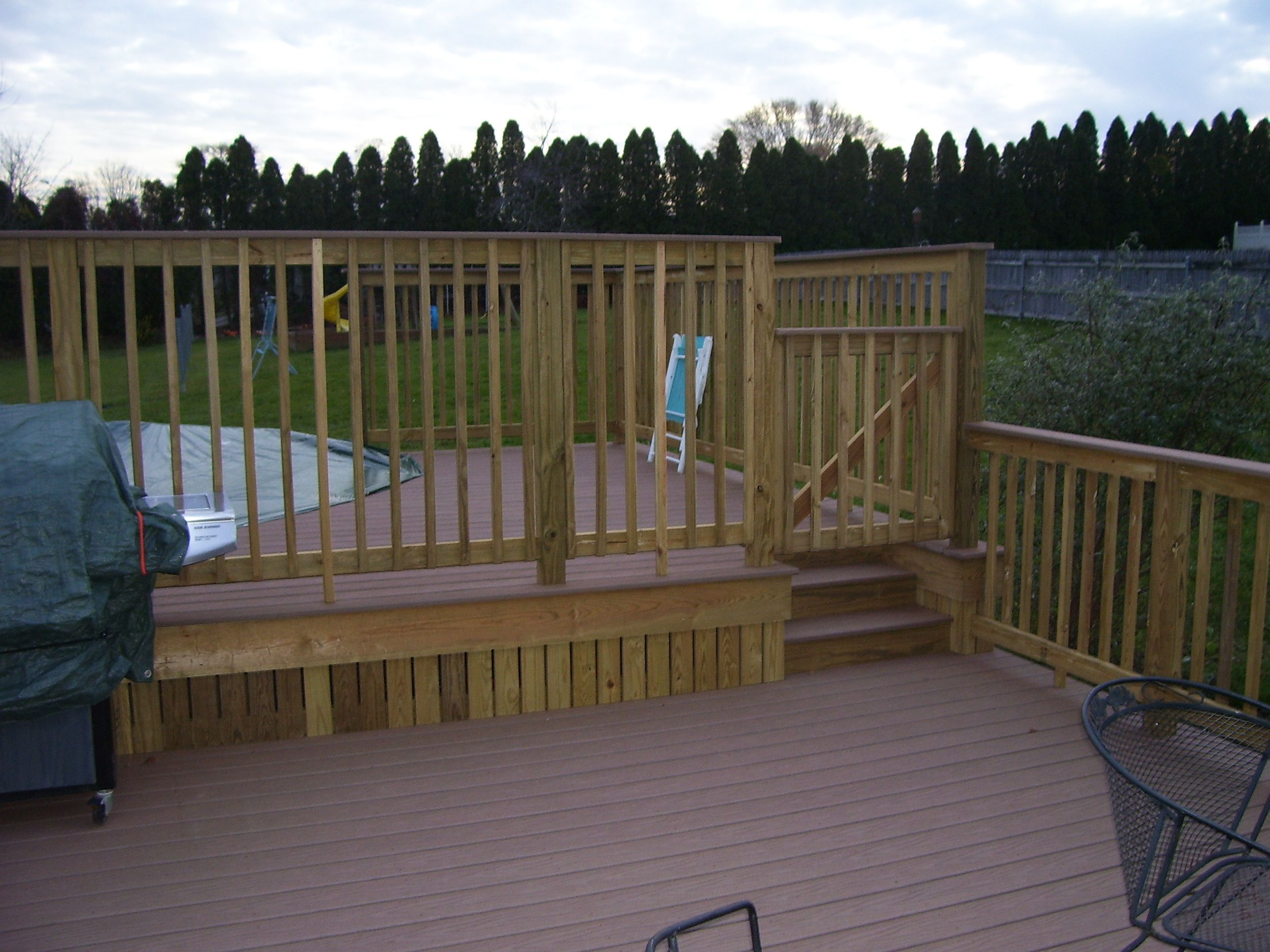Two Tier Deck Around The Pool Composite Decking And Pressure Treated Trim Pool Patio Backyard Pool Decks And Porches