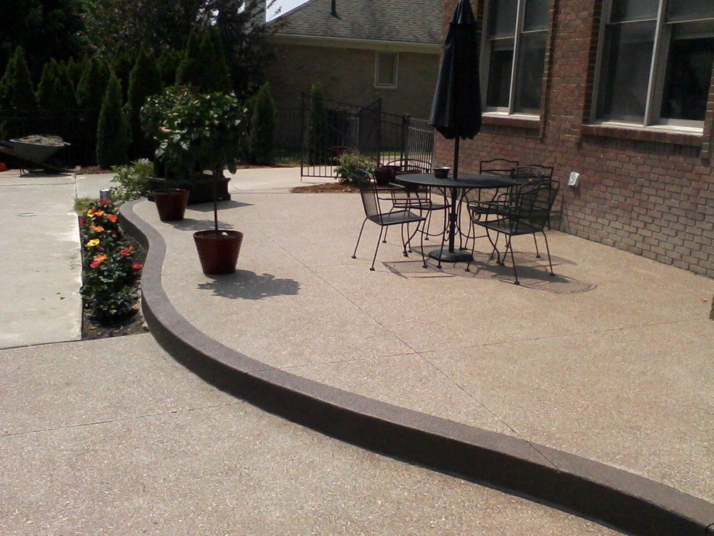 raised exposed aggregate concrete patio with accent. complete ... - Raised Concrete Patio Ideas