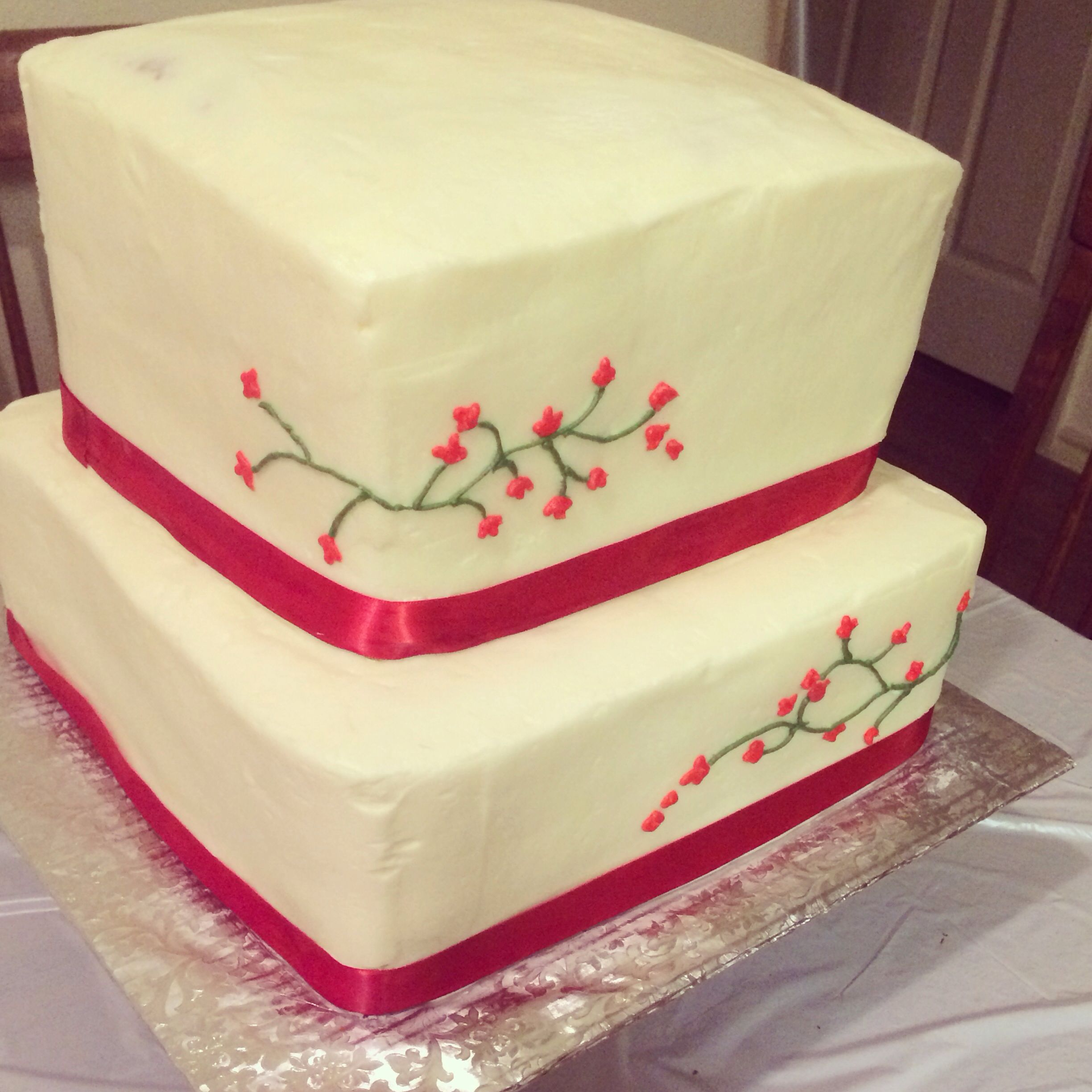 Square wedding cake with red ribbon for a border. Can also be a ...