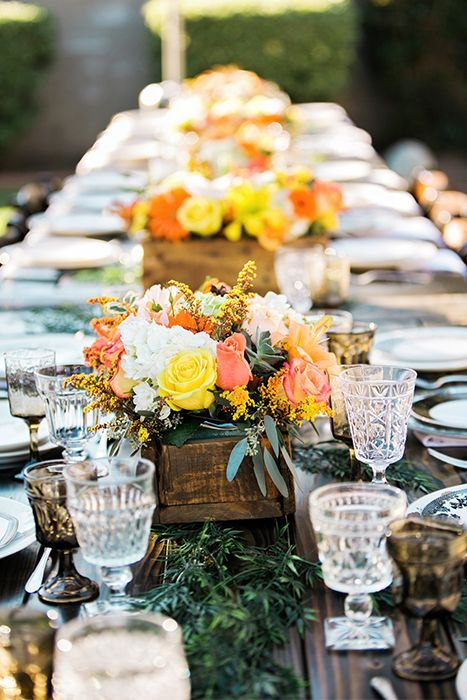 Rustic Inspired Wedding Reception Table With Bright Floral