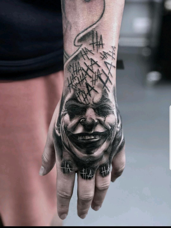 Joaquin Phoenix Joker Tattoo Joaquin Phoenix Joker Tattoo Angeltatto Bestfriendtatto Hearttat In 2020 Hand Tattoos For Guys Joker Tattoo Joker Tattoo Design