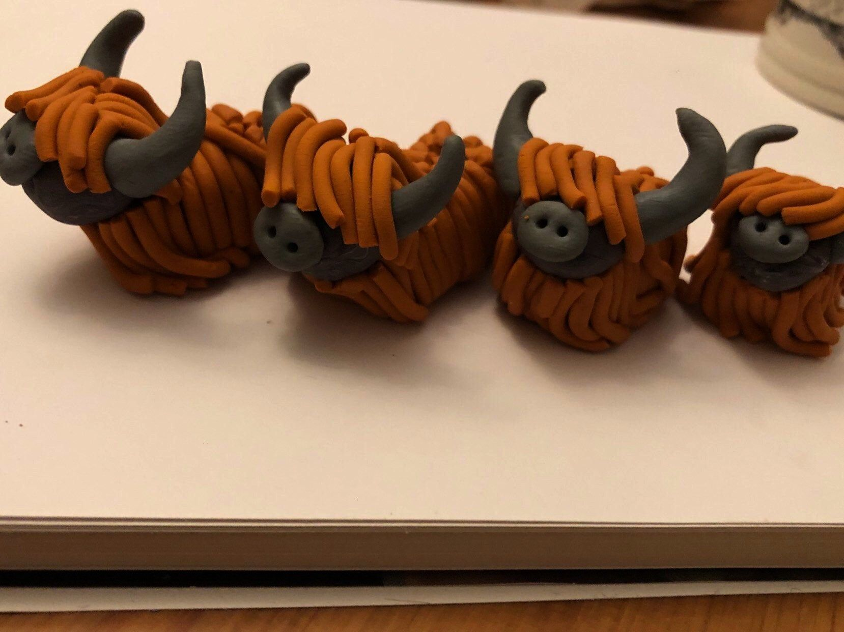 to share this item from my shop: Small handmade polymer clay  highland cow modelsExcited to share t