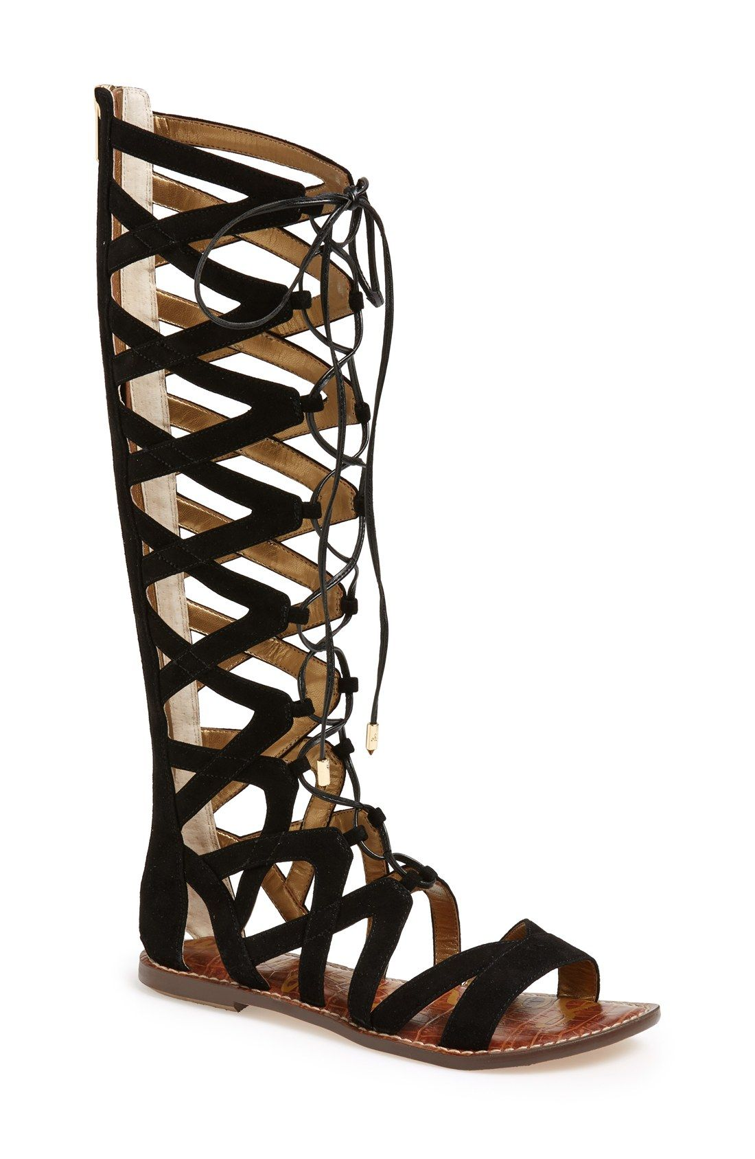 These cool and trendy gladiator sandals grab attention with its sleek black suede straps that extend knee-high.