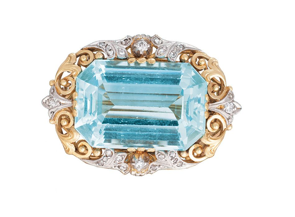 An aquamarine diamond brooch                                     14 ct. yellow gold with white gold, marked