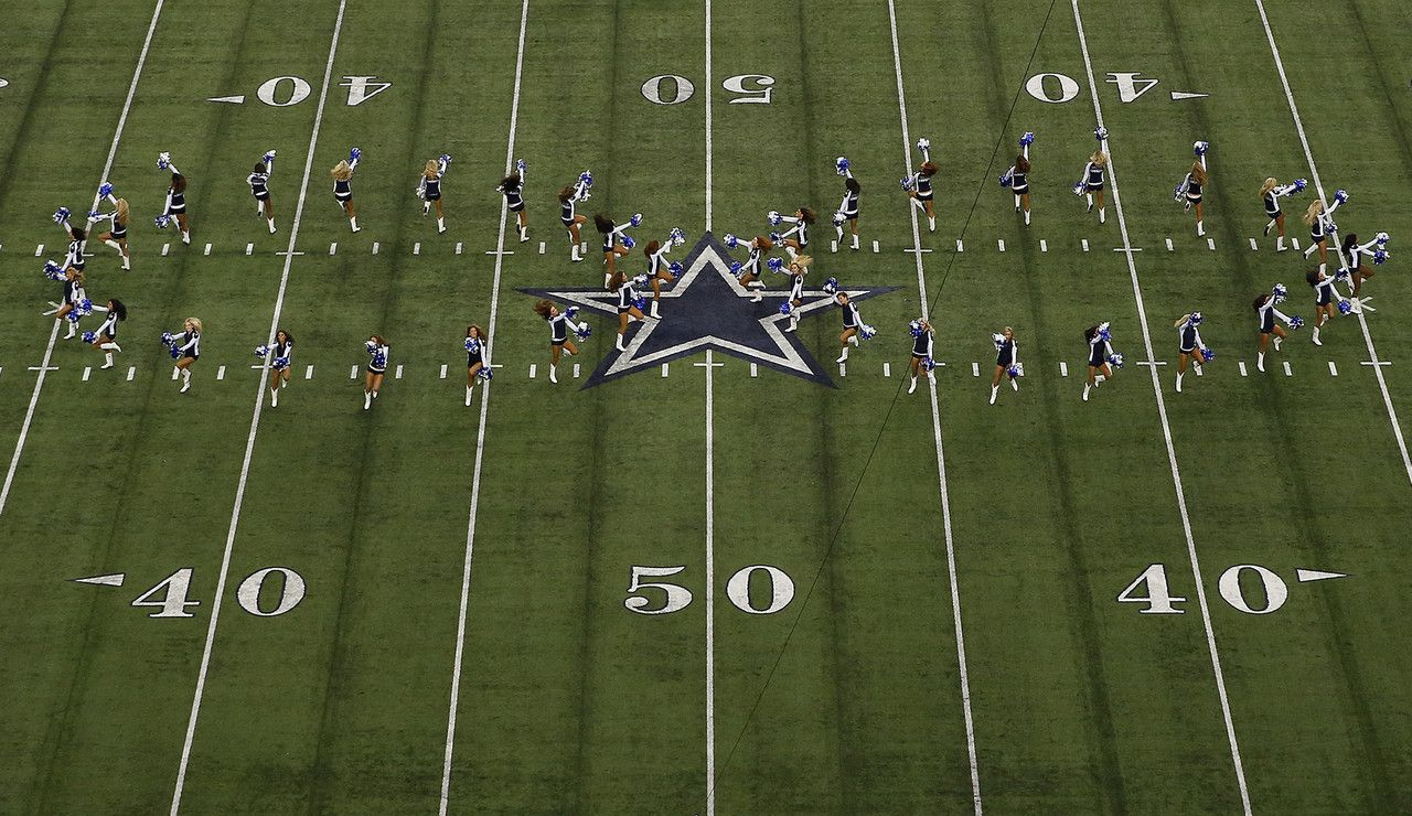 A general view of the Dallas Cowboys cheerleaders performing on the field prior to an NFL wild card playoff game between the Detroit Lions against the Dallas Cowboys at AT&T Stadium on Sunday January 4, 2015 in Arlington, Texas. Dallas won 24-20. (Aaron M. Sprecher/NFL)
