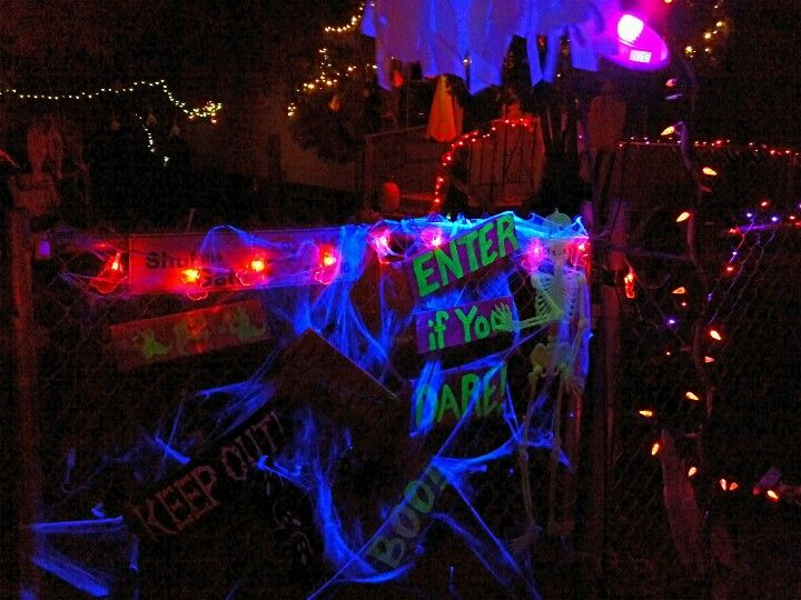 Front gate, again, love how the black light makes every thing glow - frontgate halloween