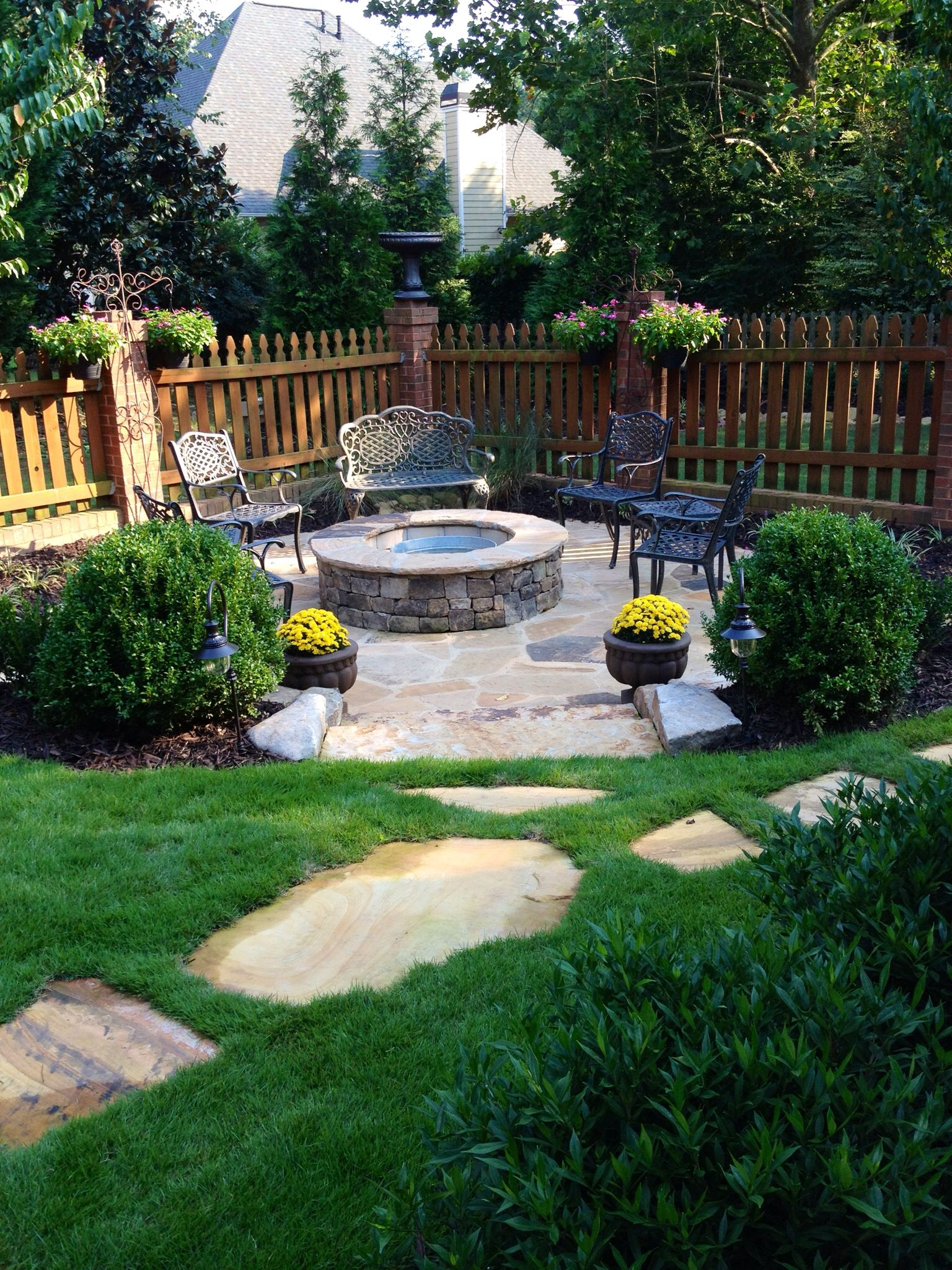 courtyard landscaping with custom stone fire pit and patio on backyard fire pit landscaping id=71039