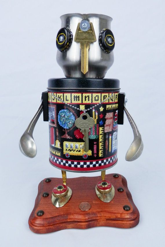 This is Thrusty. Hes a decorative, found object robot sculpture. The inside of his head can be used to hold small items. Thrusty has always had a