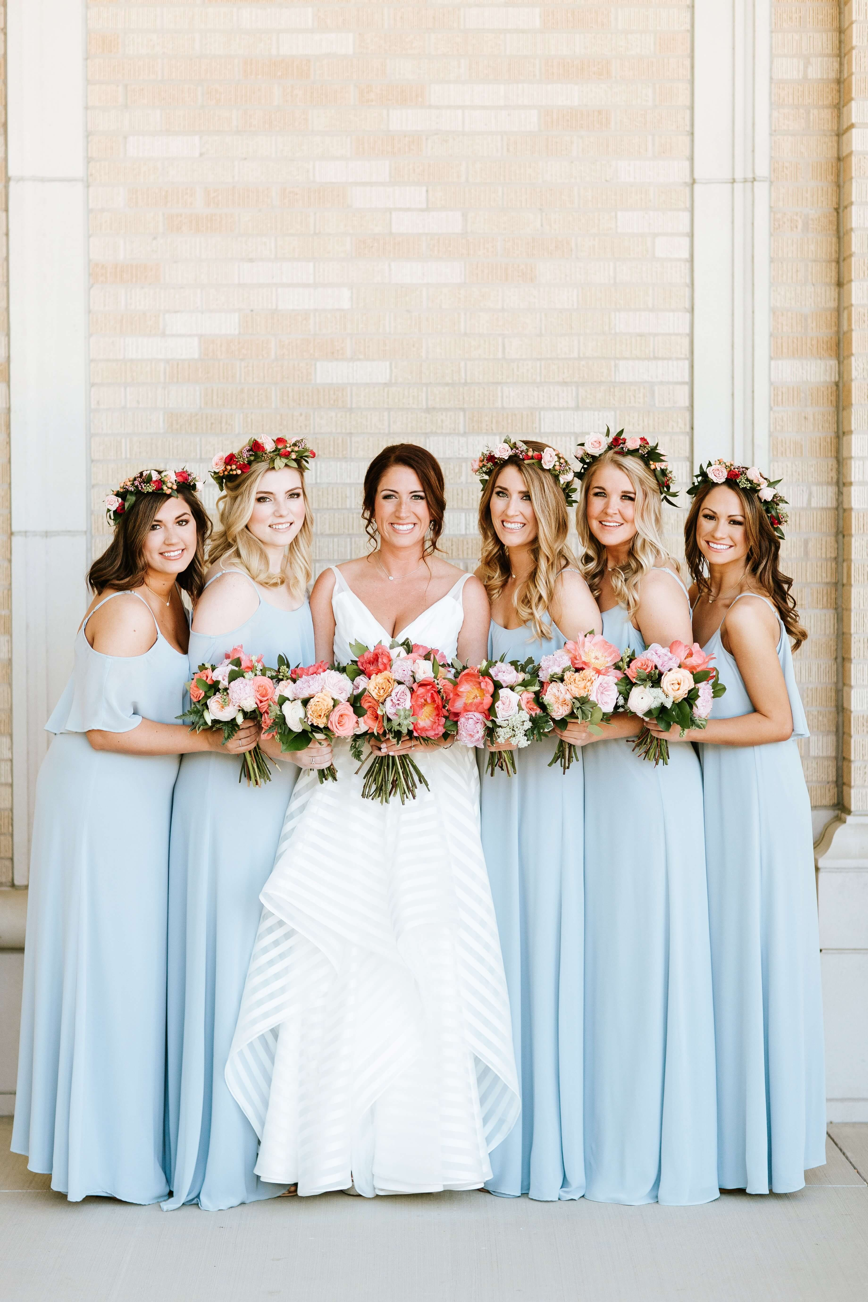 Icy blue bridesmaid gowns and flower crowns // Colorful wedding at ...