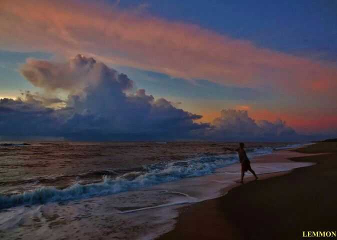 9/1/14 Labor Day Hatteras Island with storm off shore sun throws glorious colors through clouds.  Photographer credit: Mark Lemmon.