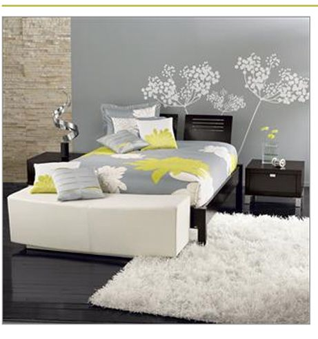 Normally yellow and gray together are not my favorite, but for this room I'll have to make an exception. :) My least favorite thing in this room would probably have to be the head board, while my favorite are the flowers on the wall.