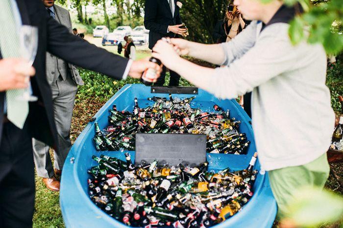 drink reception , backyard wedding ideas, bottles of bear in canoe