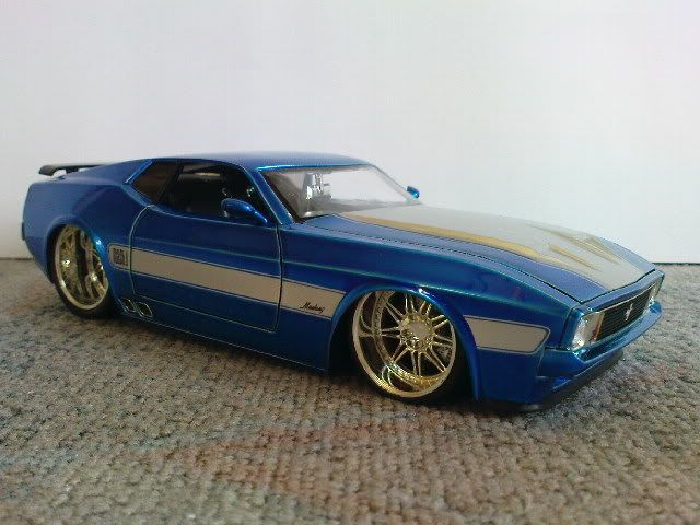 1973 Ford Mustang Mach1. I used to own a '72... jet black, red interior, dual glass packs, mag wheels... Back in another life time...