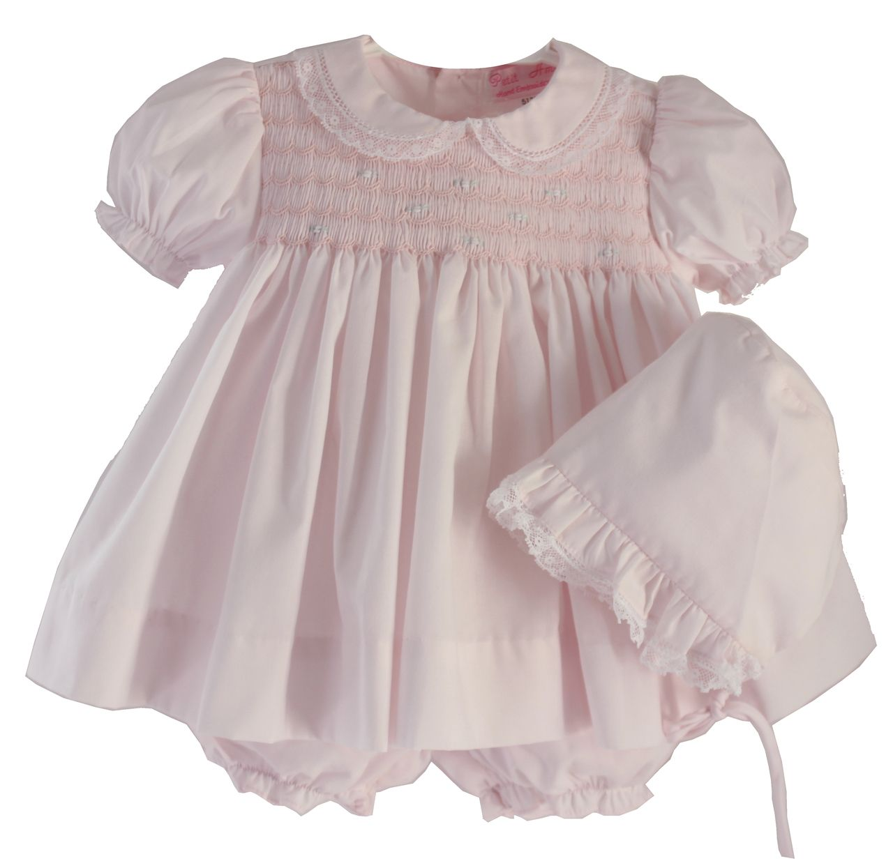 Beautiful newborn girls pink smocked dress comes with bonnet and