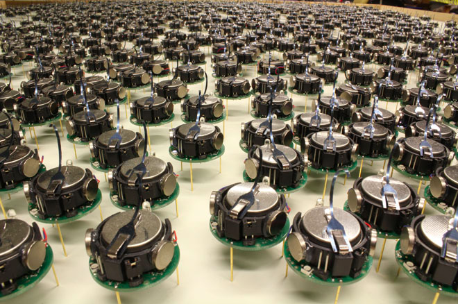 Tiny Robots Swarm Together In The Largest Assembly Of AI