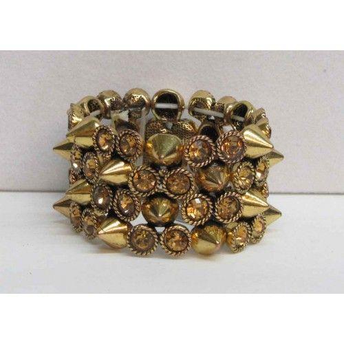 Bracelet élastique doré orné de cristaux de couleur miel.