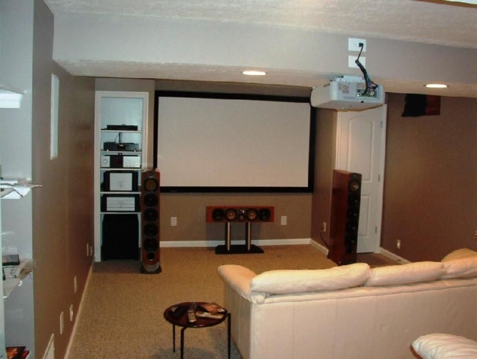 Interior cool brown small basement tv room design mixed for Cool small basements