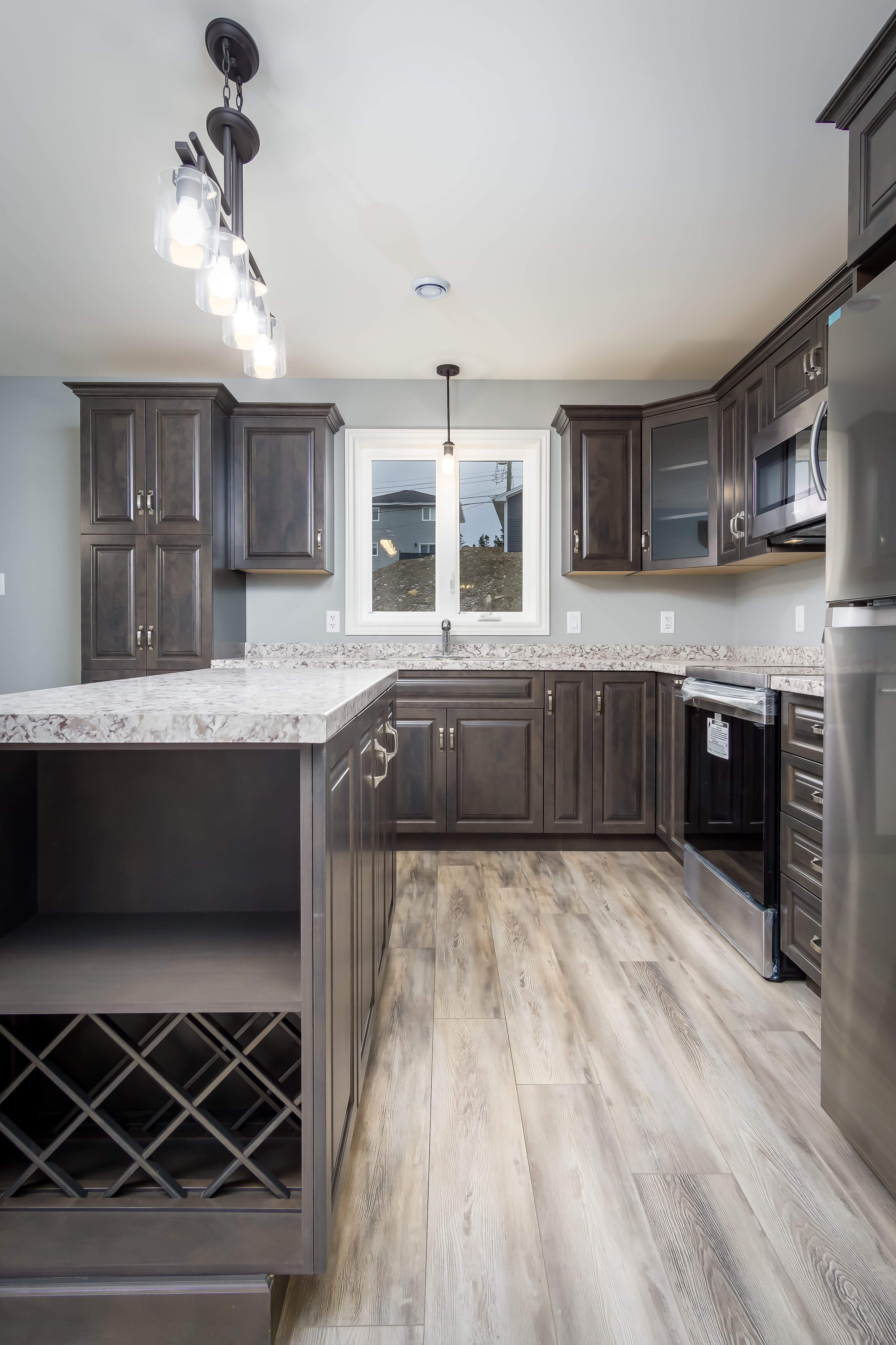 Great Use Of Space Including A Wine Rack In The Island Of This Brand New Kitchen Kitchen Cabinet Wine Rack Wine Rack Wall Wine Rack