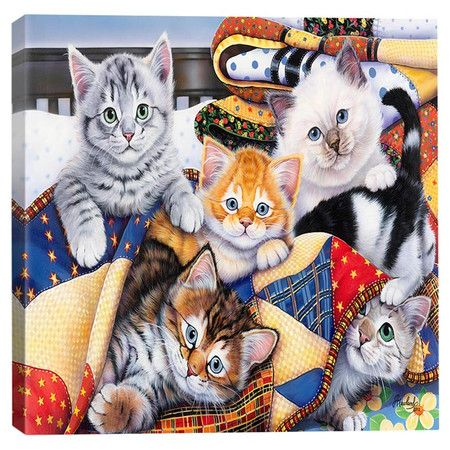 Cotton canvas print of kittens under a quilt.  Product: Canvas printConstruction Material: Wood and cotton