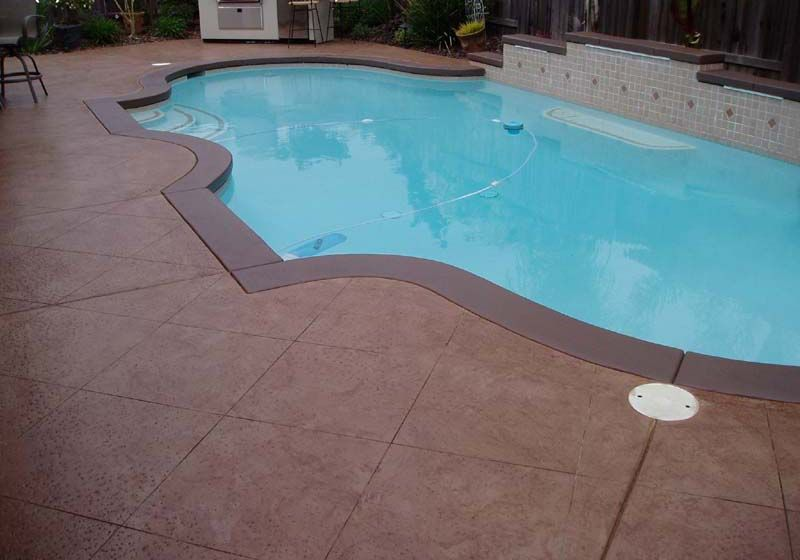 painted outdoor concrete around pool pressure washing