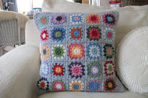large colourful grey crochet circles in a square retro cushion cover