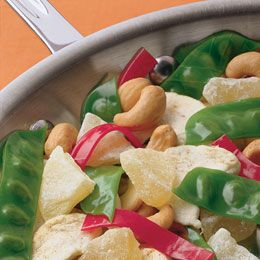 This nutty mix of veggie impostors is guaranteed to cause a stir!    Ingredients  Fruit Roll-Ups, 2 to 3 green rolls and 1 red roll  1 1/2 teaspoons hulled sunflower seeds  1 1/2 cups dried apple rings  3/4 cup dried pineapple chunks  1/2 cup cashews  X     Instructions  1.First, make a bunch of pea pods. For each one, cut a 2 1/4-inch square from a green fruit roll. Arrange five or six sunflower seeds (for peas) on the strip in a vertical row, just off center. Fold the strip in half over…