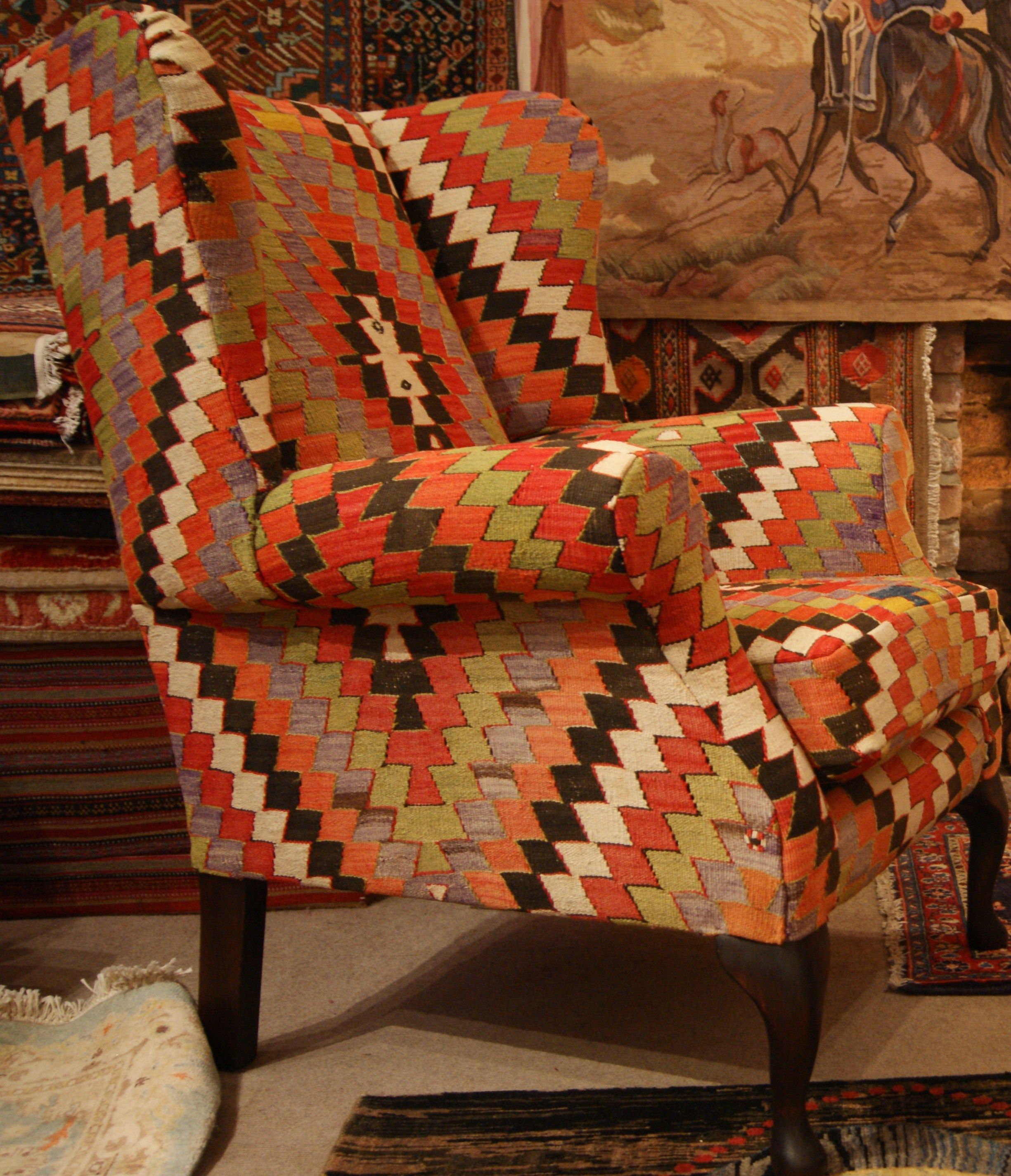 Wingback chair upholstered in Old Anatolian Kilim by The Family