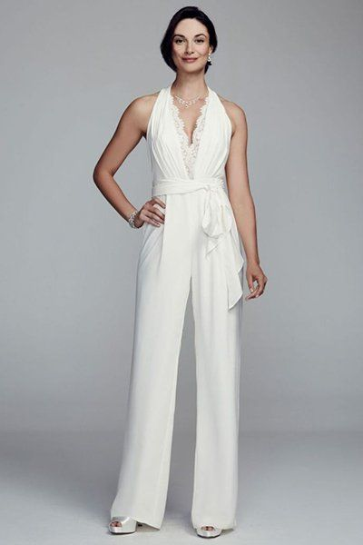 3ed9571a361 Halter crepe jumpsuit by DB Studio featuring a lace trim deep v-neckline  with lace back.
