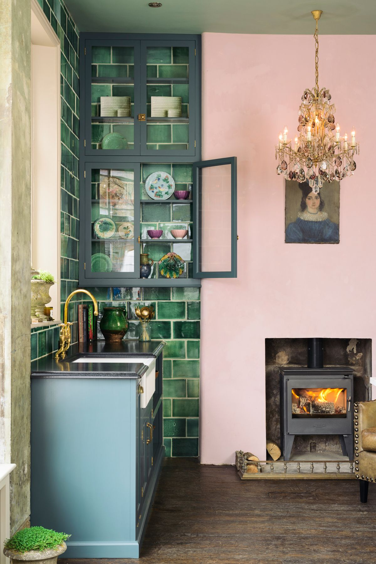 a pink green kitchen showroom cupboard and greyish blue