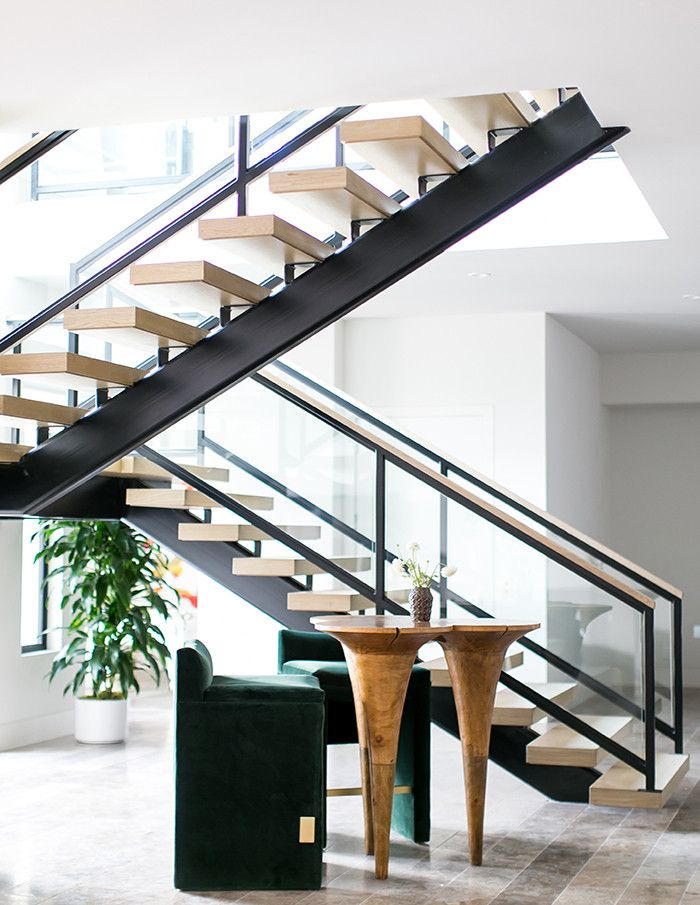 The Floating Wood Staircase And Glass Railing Create A Sleek, Modern Moment  Bathed In Natural Light By Tall Windows That Extend From The Main Floor To  The ...