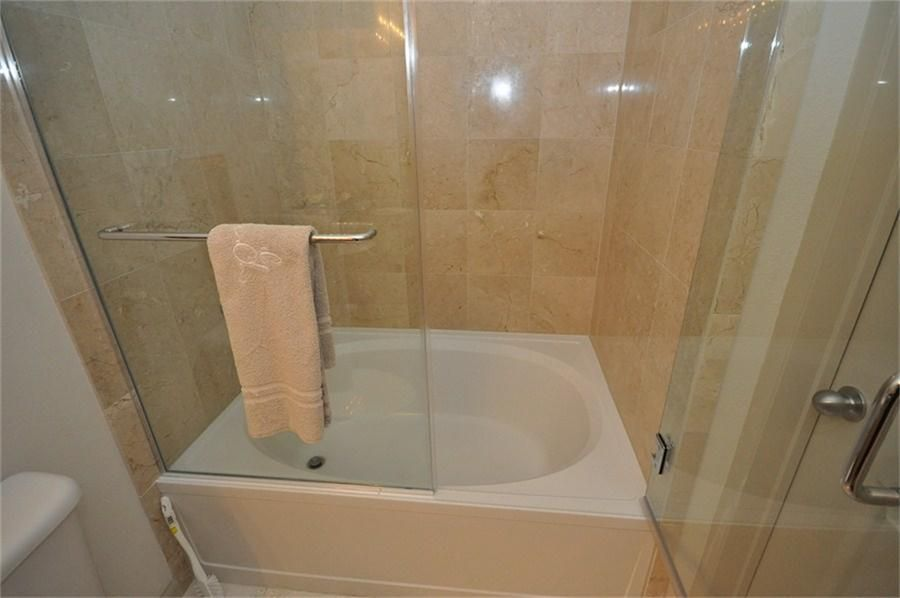 Bathroom soaker tub shower combo with folding glass for Bathroom soaking tub ideas