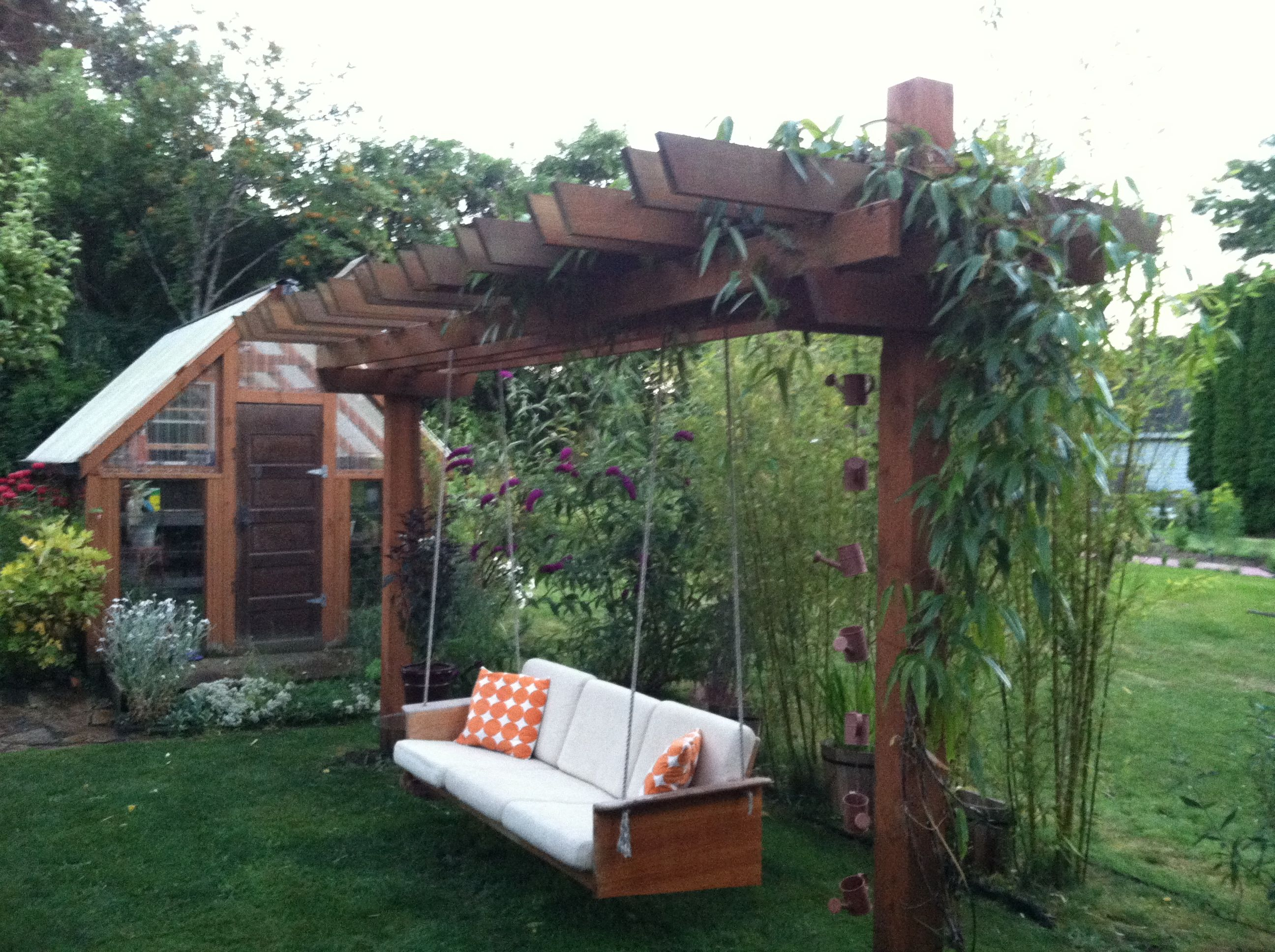 teak couch made into a pergola swing for the yard. Black Bedroom Furniture Sets. Home Design Ideas