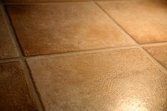 How to Repair Chipped Glazed Floor Tile-Using epoxy then paint
