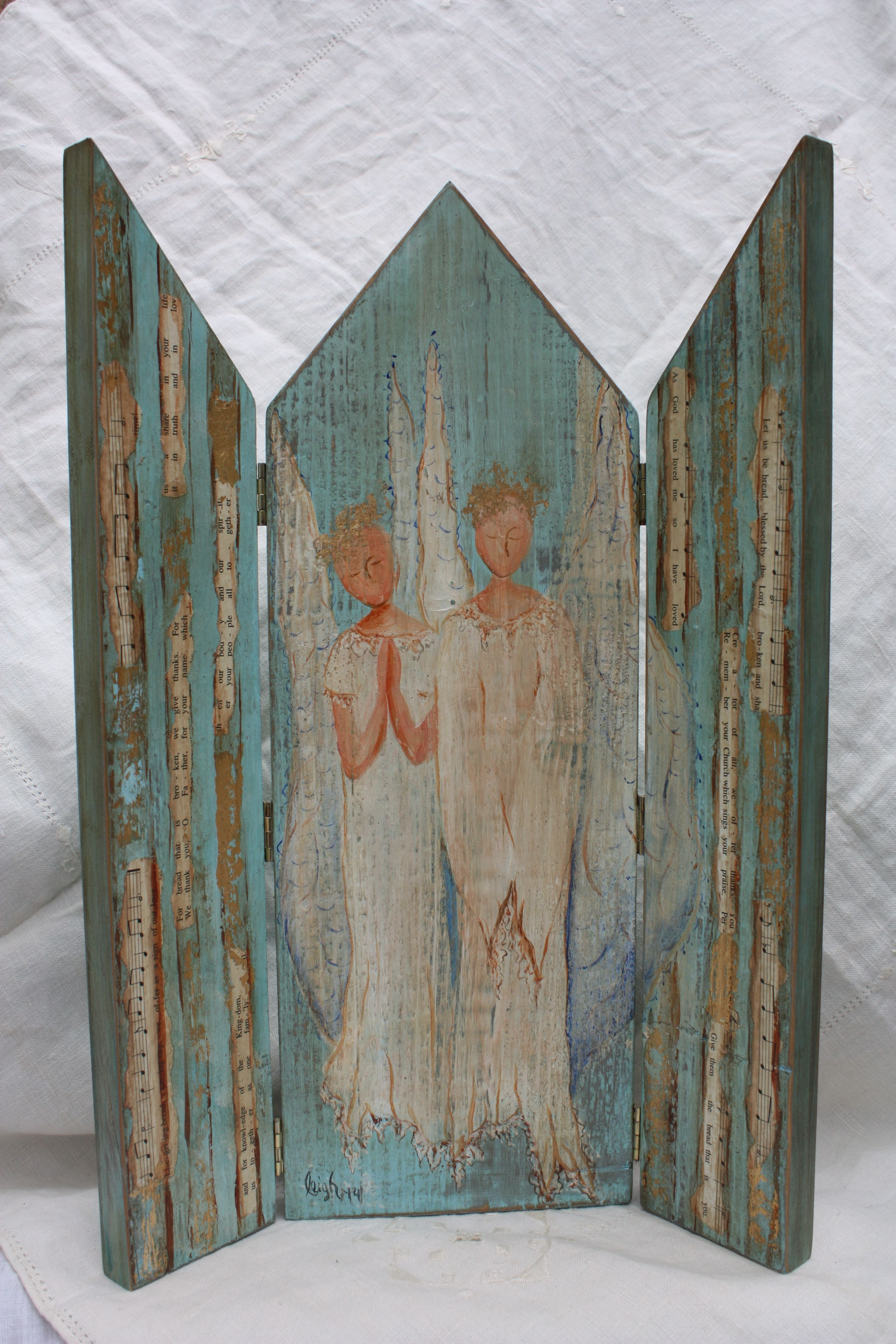 Beautiful hand painted angels standing inside the gates of heaven.  Gates are made of collaged hymnals and gold leaf accents.