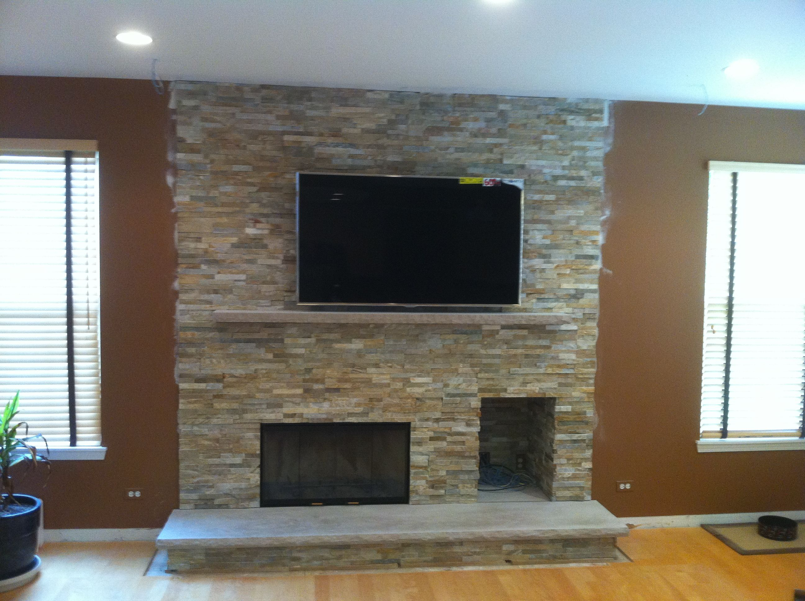 Modern Wood Burning Fireplace Rock Face Limestone Hearth
