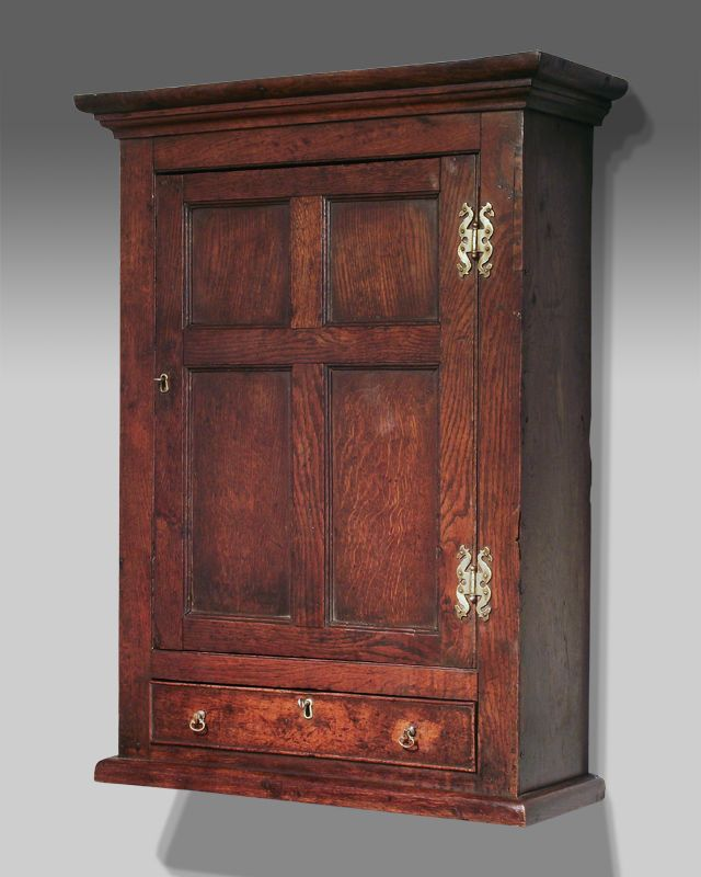 George II oak wall hanging cupboard, moulded cornice over a frame and panel cupboard  door - George II Oak Wall Hanging Cupboard, Moulded Cornice Over A Frame
