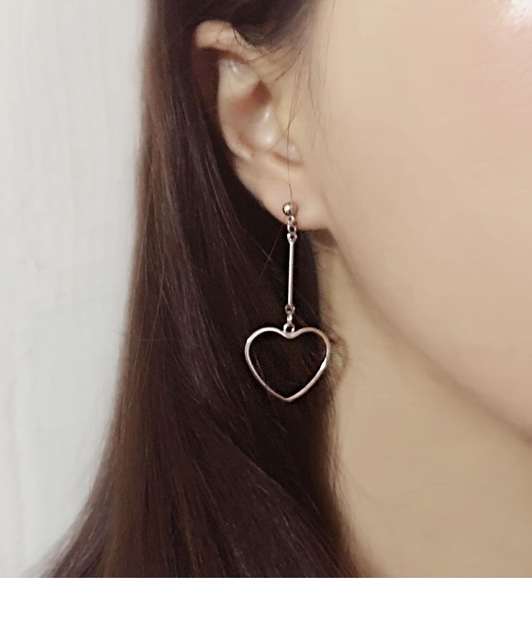 edb4f539f1b8f Dangling Hollow Heart Stud Earrings | mixxmix | Shop Korean fashion ...