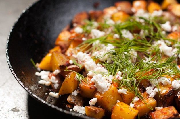 Harissa potatoes with preserved lemon, feta and fresh dill. Serve this as an easy and spicy part of a meze.