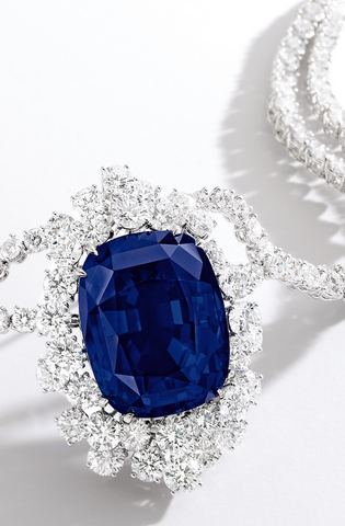 IMPRESSIVE AND RARE SAPPHIRE AND DIAMOND NECKLACE Suspending a cushion-shaped sapphire weighing 102.61 carats, surrounded by brilliant-cut diamonds, completed by a double-strand necklace set with brilliant-cut diamonds, the diamonds together weighing approximately 60.00 carats, mounted in 18 karat white gold, length approximately 460mm.
