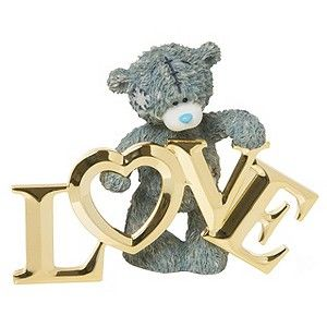 """A charming Me To You collectible featuring the adorable Tatty Teddy holding up polished golden letters to spell """"Love"""". Simple and sentimental, this figurine is the perfect gift to show a loved one just how much you care."""