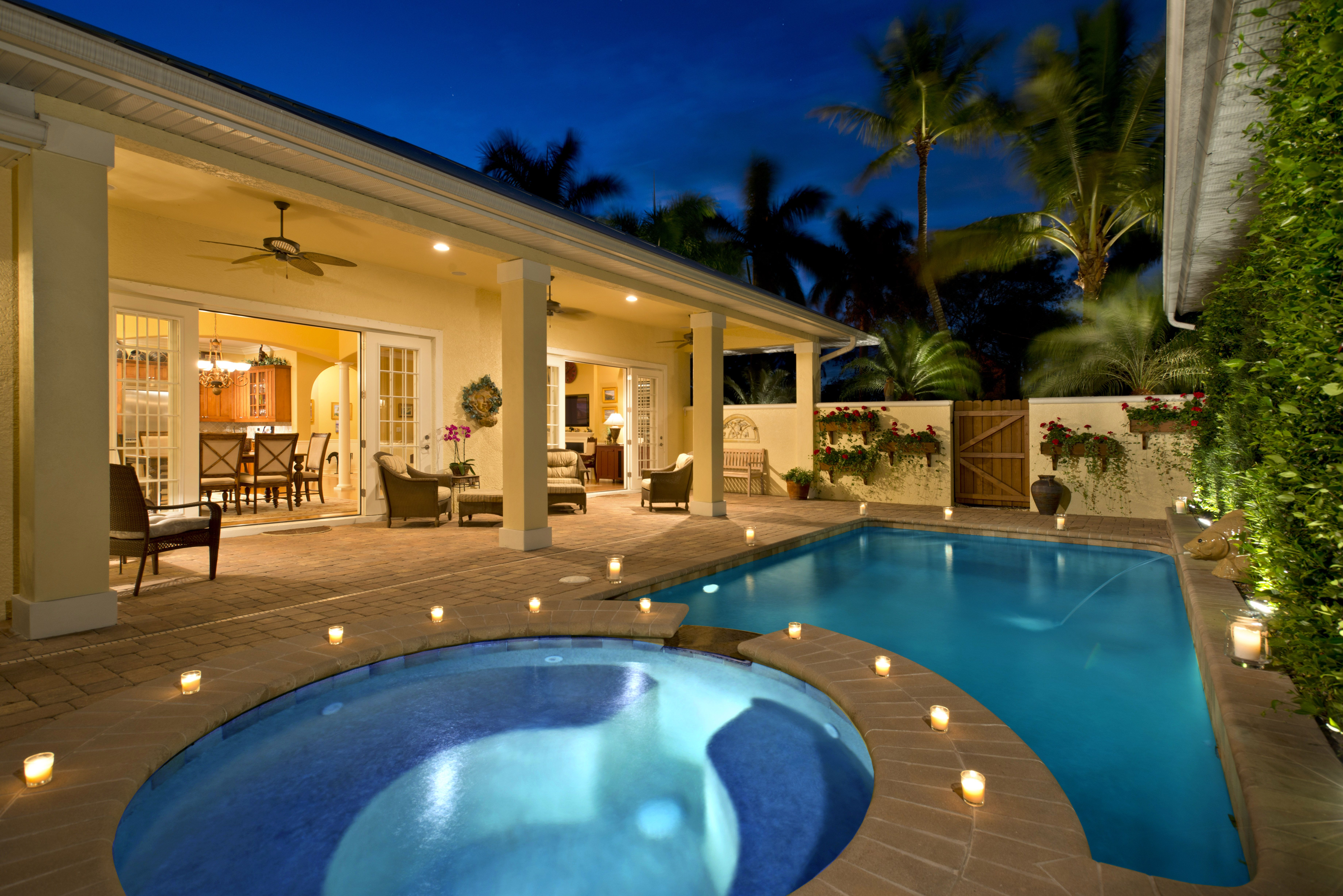 Enjoy the covered courtyard complete with pool spa and