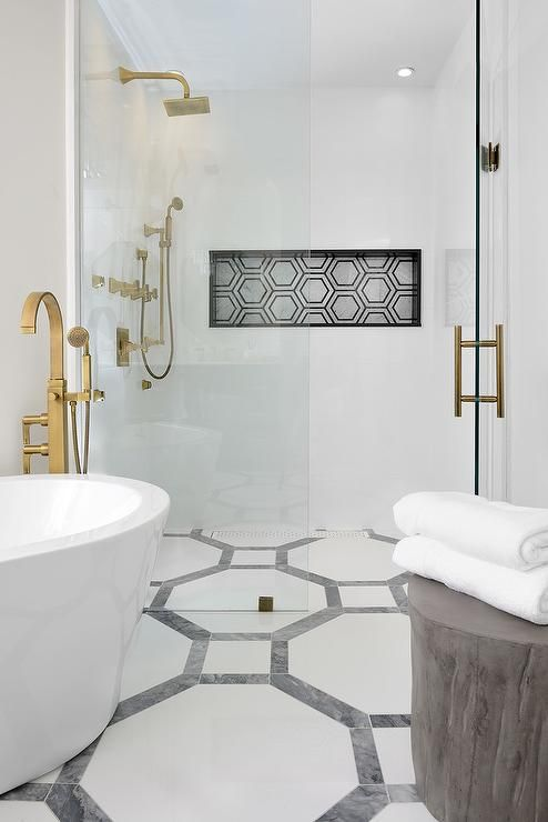 A Corner Oval Bathtub Is Paired With A Floor Mount Brushed